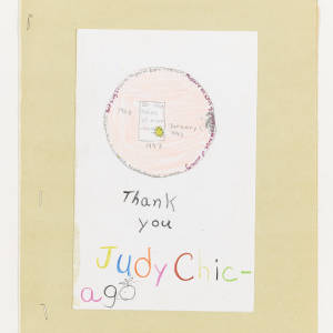 Chilren's drawing features a peach colored circle with a yellow sun inside. Below thank you is written in black and Judy Chicago is written in mulit-colored letters.